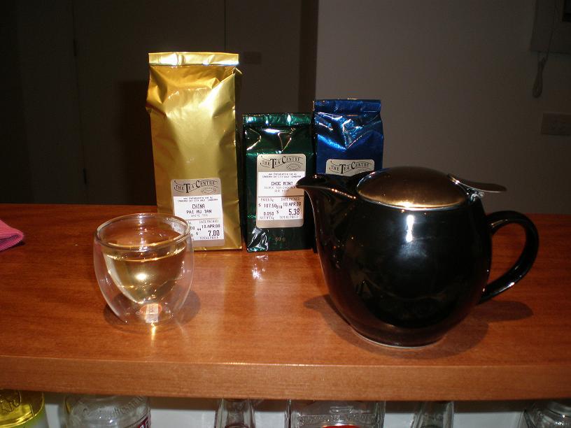 New tea pot, cup and tea